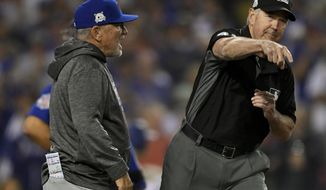 Chicago Cubs manager Joe Maddon, left, is thrown out of the game by umpire Mike Winters, during the seventh inning against the Los Angeles Dodgers in Game 1 of baseball's National League Championship Series in Los Angeles, Saturday, Oct. 14, 2017. (AP Photo/Mark J. Terrill)