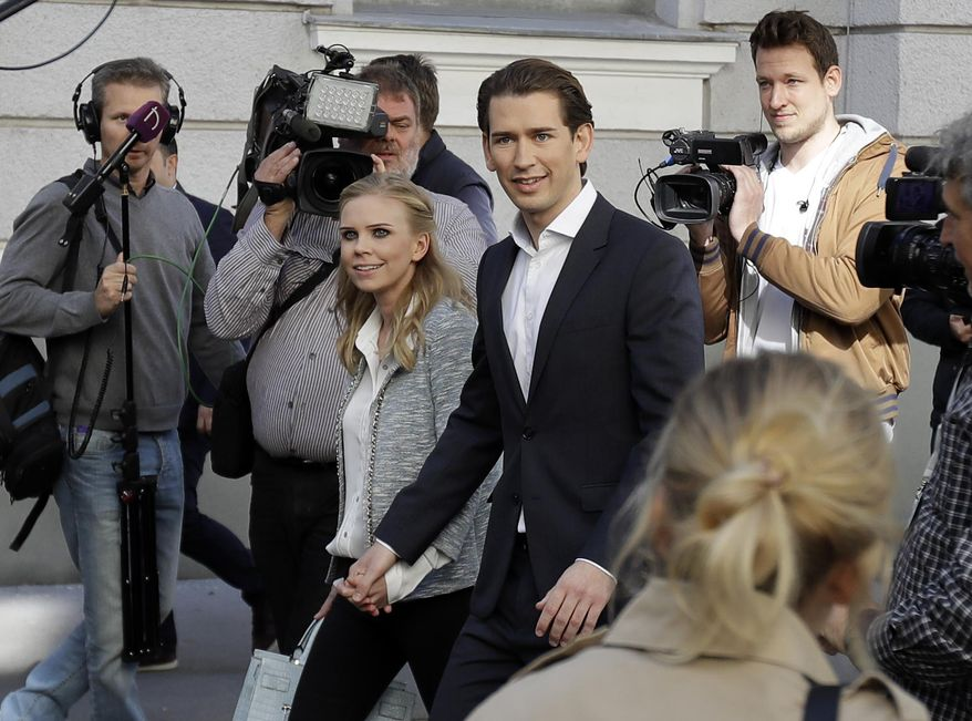 Foreign Minister Sebastian Kurz, head of Austrian People's Party, and his girlfriend Susanne Thier arrive to the polling station to casts their vote in Vienna, Austria, Sunday, Oct. 15, 2017, when about 6.4 million people are eligible to vote in the national elections. (AP Photo/Matthias Schrader)