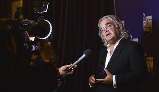 BFI Fellowship winner Paul Greengrass in the press room at the Film Festival Awards, part of the BFI London Film Festival, at Banqueting House, London Saturday, Oct. 14, 2017.  (Matt Crossick/PA via AP)