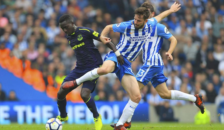 Everton's Idrissa Gueye, left, and Brighton & Hove Albion's Davy Propper battle for the ball during their English Premier League soccer match at the AMEX Stadium in Brighton, England, Sunday Oct. 15, 2017. (Gareth Fuller/PA via AP)
