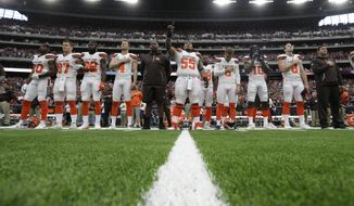 The Cleveland Browns stand during the playing of the national anthem before an NFL football game against the Houston Texans on Sunday, Oct. 15, 2017, in Houston. (AP Photo/Eric Gay)