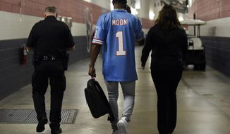Houston Texans quarterback Deshaun Watson leaves a news conference wearing a Houston Oilers' Warren Moon jersey after an NFL football game against the Cleveland Browns on Sunday, Oct. 15, 2017, in Houston. Watson threw three touchdown passes and the Texans defeated the Browns 33-17. (AP Photo/Eric Christian Smith)