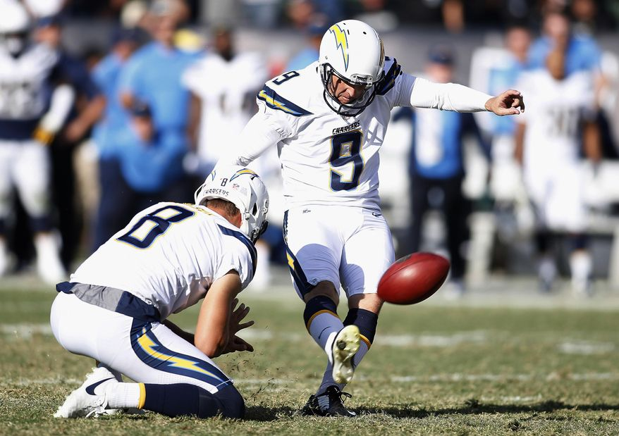Los Angeles Chargers kicker Nick Novak (9) kicks the game winning field goal from the hold of Drew Kaser against the Oakland Raiders during the second half of an NFL football game in Oakland, Calif., Sunday, Oct. 15, 2017. (AP Photo/D. Ross Cameron)