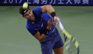 Rafael Nadal of Spain serves against Marin Cilic of Croatia during their men's singles semifinals match in the Shanghai Masters tennis tournament at Qizhong Forest Sports City Tennis Center in Shanghai, China, Saturday, Oct. 14, 2017 (AP Photo/Andy Wong)