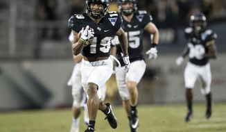 Central Florida punt returner and defensive back Mike Hughes (19) sprints away from the defenders to score on a punt-return during the second half of an NCAA college football game against East Carolina, Saturday, Oct. 14, 2017, in Orlando, Fla. (AP Photo/Willie J. Allen Jr.) ** FILE **