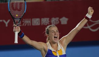 Anastasia Pavlyuchenkova of Russia celebrates after defeated Daria Gavrilova of Australia winning the final match at the Hong Kong Open tennis tournament in Hong Kong, Sunday, Oct. 15, 2017. (AP Photo/Vincent Yu)