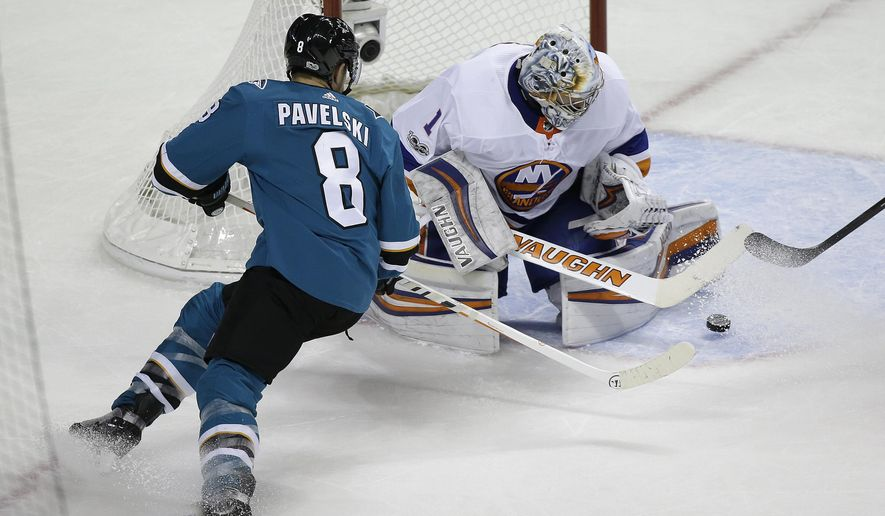 New York Islanders goalie Thomas Greiss stops a shot by San Jose Sharks center Joe Pavelski (8) during the second period of an NHL hockey game Saturday, Oct. 14, 2017, in San Jose, Calif. (AP Photo/Eric Risberg)