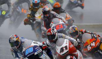 Moto3 rider Jorge Martin of Spain steers his Honda leads the pack of riders at the MotoGP Japanese Motorcycle Grand Prix at the Twin Ring Motegi circuit in Motegi, north of Tokyo, Sunday, Oct. 15, 2017. (AP Photo/Shizuo Kambayashi)