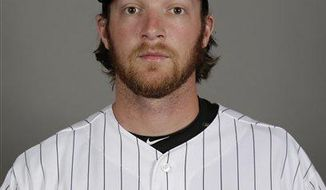 In this Feb. 27, 2016, file photo, of Daniel Webb, of the Chicago White Sox baseball team, poses in uniform. Former White Sox relief pitcher Webb was killed in an ATV accident in Humphreys County, Tenn., on Saturday, Oct. 14, 2017. He was 28. (AP Photo/Matt York, File)