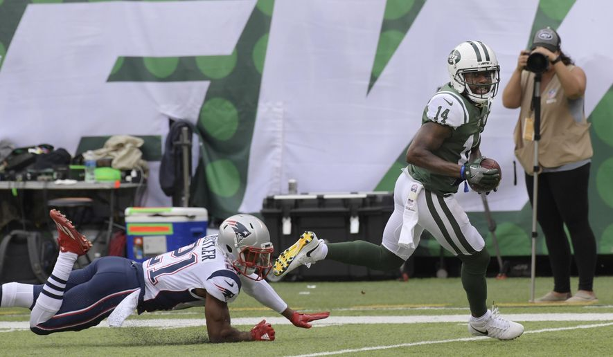 New York Jets wide receiver Jeremy Kerley, right, runs away from New England Patriots' Malcolm Butler (21) for a touchdown during the first half of an NFL football game Sunday, Oct. 15, 2017, in East Rutherford, N.J. (AP Photo/Bill Kostroun)