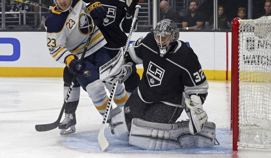 Buffalo Sabres center Sam Reinhart (23) moves in as Los Angeles Kings goalie Jonathan Quick deflects the puck during the first period of an NHL hockey game in Los Angeles on Saturday, Oct. 14, 2017. (AP Photo/Reed Saxon)