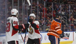 Ottawa Senators' Mike Hoffman (68) and Tom Pyatt (10) celebrate a goal against the Edmonton Oilers during the first period of an NHL hockey game Saturday, Oct. 14, 2017, in Edmonton, Alberta. (Jason Franson/The Canadian Press via AP)