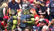 Enthusiastic fans enjoy the match between the Houston Texans and Cleveland Browns during an NFL football game on Sunday. (Associated Press)