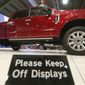 In this Monday, Oct. 9, 2017, photo, a Ford F-Series Super Duty Limited sits on display during the State Fair of Texas in Dallas. America's favorite luxury vehicle is a pickup truck. Buyers are increasingly outfitting their pickups with all the comforts of luxury cars, from heated and cooled seats to backup cameras to panoramic glass roofs. (AP Photo/LM Otero)