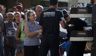 People wait in line to get Duracell batteries on Friday, Oct. 13, 2017, in Barranquitas, Puerto Rico. (Ricardo Arduengo/AP Images for Duracell)