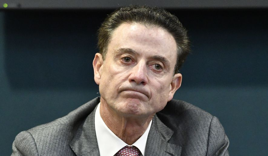 FILE - In this Oct. 20, 2016, file photo, Louisville head basketball coach Rick Pitino reacts to a question during a press conference in Louisville, Ky. Louisville's Athletic Association has officially fired coach Rick Pitino, Monday, Oct. 16, 2017, nearly three weeks after the school acknowledged that its men's basketball program is being investigated as part of a federal corruption probe. (AP Photo/Timothy D. Easley, File) **FILE**