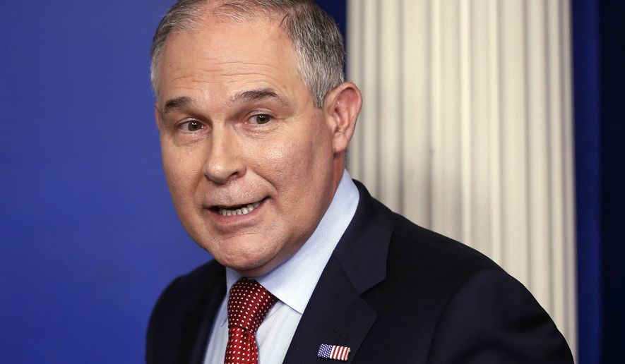 FILE - In this June 2, 2017 file photo, EPA Administrator Scott Pruitt looks back after speaking to the media during the daily briefing in the Brady Press Briefing Room of the White House in Washington. Top-ranking Congressional Democrats are calling on a federal watchdog to review whether Pruitt broke the law by making a video for a private group opposing an Obama-era clean-water rule. Pruitt flew to Colorado for an August event organized by the National Cattlemen's Beef Association, an industry trade association representing cattle producers. While at the ranch, Pruitt recorded a video urging the group's members to file comments supporting the repeal of EPA's Waters of the United States rule. (AP Photo/Pablo Martinez Monsivais)