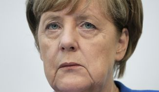 German Chancellor and chairwoman of the German Christian Democratic Party (CDU), Angela Merkel, attends a press conference at the party's headquarter in Berlin, Germany, Monday, Oct. 16, 2017 one day after the elections in the German state of Lower Saxony. (AP Photo/Michael Sohn)