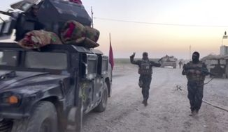 This image made from a video shows Iraqi soldiers and military vehicles in the Qatash area toward Kirkuk gas plant, south of Kirkuk, Iraq, Monday, Oct. 16, 2017.  Iraqi state media say federal troops have entered disputed territories occupied by the nation's Kurds. The move comes three years after Kurdish militias seized the areas outside their autonomous region to defend against an advance by the Islamic State extremist group. (APTN via AP)