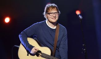 "In this file photo dated Sunday, March 12, 2017, British singer Ed Sheeran performs during the Italian State RAI TV program ""Che Tempo che Fa,"" in Milan, Italy. Sheeran has told fans via Instagram that he's had a bicycle injury and posted a photo of his arm in a cast, advising fans he may have to change some concert dates with a series of shows in Asia scheduled to start on Oct. 22. (AP Photo/Antonio Calanni, FILE)"