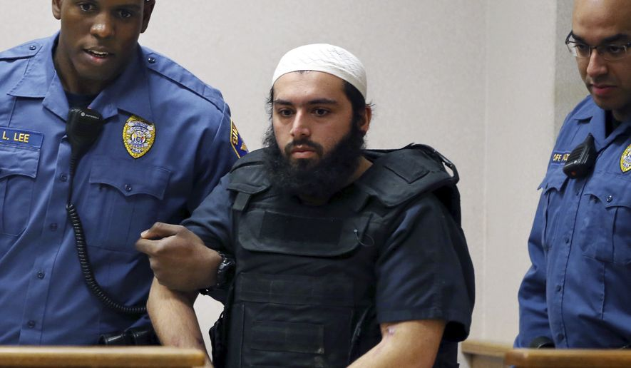FILE - In this file photo from Tuesday, Dec. 20, 2016, Ahmad Khan Rahimi, the man accused of setting off bombs in New Jersey and New York in September is led into court in Elizabeth, N.J. On Monday, Oct. 16, 2017 jurors found Rahimi guilty of all charges, including counts of using a weapon of mass destruction and bombing a public place. The Afghanistan-born man who was living in Elizabeth, New Jersey at the time of the bombing, faces a maximum punishment of life in prison. (AP Photo/Mel Evans, File)