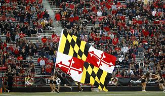 A cheerleader carries a Maryland state flag during an NCAA college football game between Maryland and Northwestern in College Park, Md., Saturday, Oct. 14, 2017. (AP Photo/Patrick Semansky) **FILE**