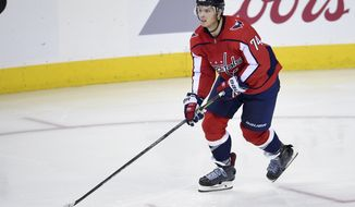 Washington Capitals defenseman John Carlson (74) skates with the puck during the third period of a NHL hockey game against the Pittsburgh Penguins, Wednesday, Oct. 11, 2017, in Washington. The Penguins won 3-2. (AP Photo/Nick Wass)
