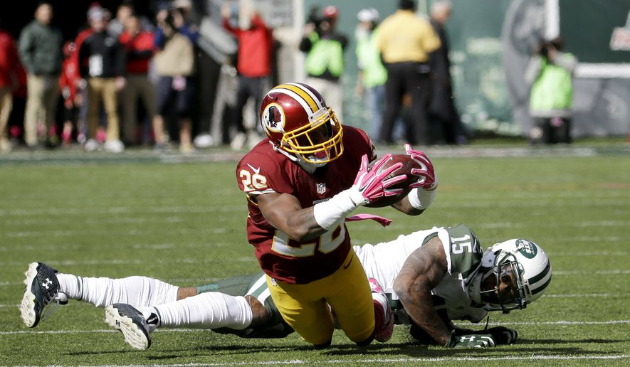 File-This Oct. 18, 2015, file photo shows Washington Redskins cornerback Bashaud Breeland, front, making an interception during the first half of an NFL football game,  in East Rutherford, N.J. (AP Photo/Seth Wenig, File) **FILE**