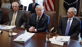 President Donald Trump speaks during a cabinet meeting at the White House, Monday, Oct. 16, 2017, in Washington, as Secretary of State Rex Tillerson, left, and Secretary of Defense Jim Mattis, right, listen.  (AP Photo/Evan Vucci)
