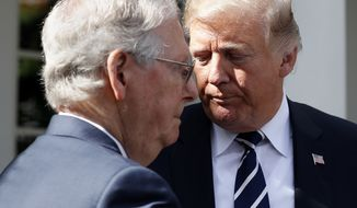 President Donald Trump turns from the podium to allow Senate Majority Leader Mitch McConnell of Ky., to speak in the Rose Garden after their meeting at the White House, Monday, Oct. 16, 2017, in Washington. (AP Photo/Alex Brandon)
