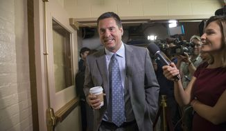 "In this July 28, 2017, file photo, House Intelligence Committee Chairman Rep. Devin Nunes, R-Calif., walks on Capitol Hill in Washington. A political research firm behind a dossier of allegations about President Donald Trump's connections to Russia is balking at subpoenas from the House intelligence committee, with a lawyer for the firm questioning the legitimacy of the panel's probe into Russian meddling. Joshua Levy, a lawyer for Fusion GPS, said in a letter to the panel on Oct. 16 that Nunes is acting ""in bad faith."" (AP Photo/J. Scott Applewhite, File)"