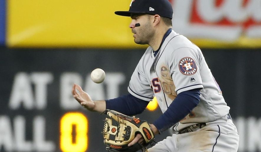 Houston Astros' Jose Altuve bobbles a ball hit by New York Yankees' Chase Headley during the fourth inning of Game 3 of baseball's American League Championship Series Monday, Oct. 16, 2017, in New York. (AP Photo/Kathy Willens)