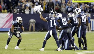 Tennessee Titans inside linebacker Wesley Woodyard (59) celebrates with teammates after Woodyard brought down Indianapolis Colts quarterback Jacoby Brissett to stop a Colts' drive late in the fourth quarter in an NFL football game Monday, Oct. 16, 2017, in Nashville, Tenn. (AP Photo/James Kenney)