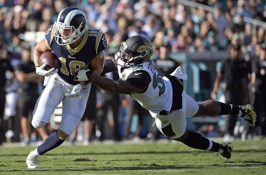 Los Angeles Rams wide receiver Cooper Kupp (18) is stopped by Jacksonville Jaguars defensive end Dante Fowler Jr. after a reception during the first half of an NFL football game, Sunday, Oct. 15, 2017, in Jacksonville, Fla. (AP Photo/Phelan M. Ebenhack)