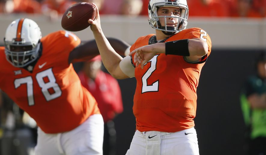 Oklahoma State quarterback Mason Rudolph (2) passes in the fourth quarter of an NCAA college football game against Baylor in Stillwater, Okla., Saturday, Oct. 14, 2017. Oklahoma State won 59-16. (AP Photo/Sue Ogrocki)