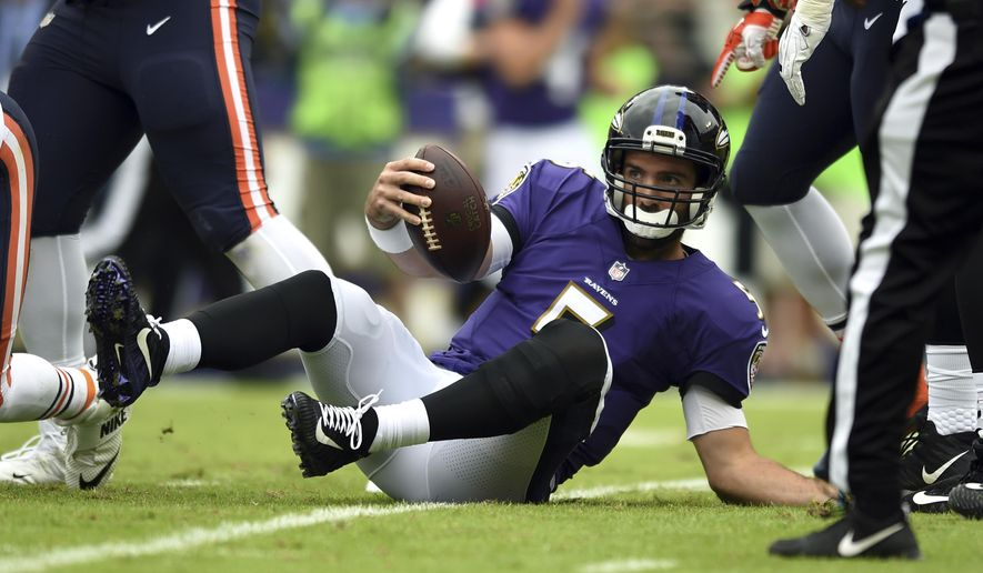 Baltimore Ravens quarterback Joe Flacco gets up after being sacked by Chicago Bears inside linebacker Danny Trevathan in the first half of an NFL football game, Sunday, Oct. 15, 2017, in Baltimore. (AP Photo/Gail Burton)