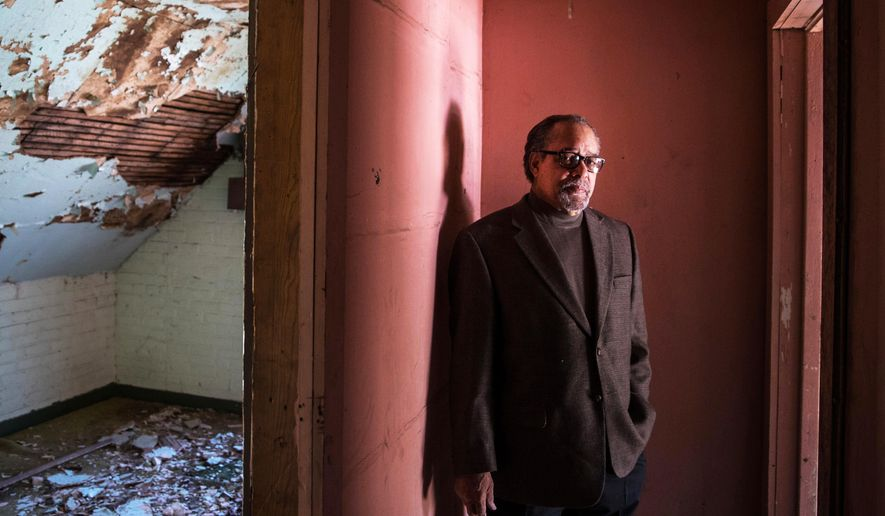 In a Wednesday, Oct 11, 2017 photo, James Calloway poses for a portrait in the former site of the Great Plains Black History Museum located in the Western Telephone Exchange Building in Omaha, Neb. The Great Plains Black History Museum is leaving a shopping mall for a larger location in northeast Omaha. (Chris Machian//Omaha World-Herald via AP)