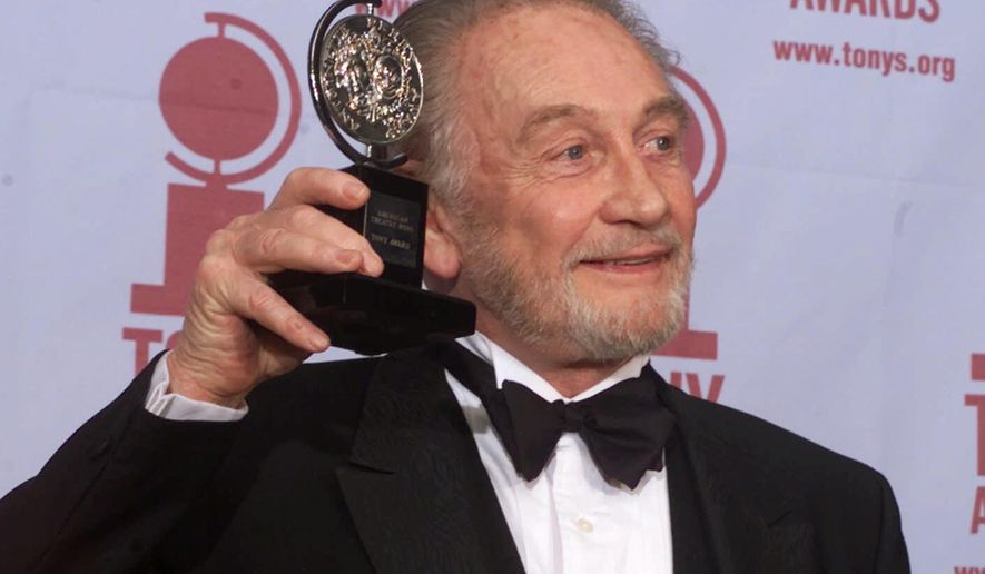 "FILE - In this file photo dated Sunday, June 4, 2000, Roy Dotrice poses with his Tony award for Best Featured Actor in a Play for his work in ""A Moon For The Misbegotten,"" at the 54th annual Tony Awards ceremony in New York.  The family of veteran British actor Roy Dotrice said Monday Oct. 16, 2017, that he has died aged 94, in his London home. (AP Photo/Richard Drew, FILE)"