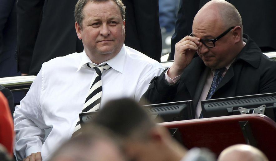 FILE- In this Sunday, May 24, 2015 file photo, Newcastle United's owner Mike Ashley, left, and managing director Lee Charnley, right, are seen in the stand ahead of their English Premier League soccer match between Newcastle United and West Ham United's at St James' Park, Newcastle, England. English Premier League club Newcastle is up for sale. (AP Photo/Scott Heppell, File)