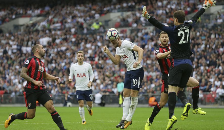Tottenham's Harry Kane, centre, makes an attempt on goal during the English Premier League soccer match between Tottenham Hotspur and AFC Bournemouth at Wembley stadium in London, Saturday Oct. 14, 2017. (AP Photo/Tim Ireland)