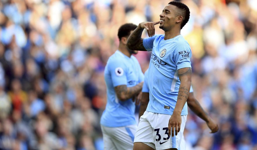 Manchester City's Gabriel Jesus celebrates scoring his side's fourth goal of the game during the English Premier League soccer match between Manchester City and Stoke City at Etihad Stadium, Manchester, England, Saturday, Oct. 14, 2017. (Mike Egerton/PA via AP)