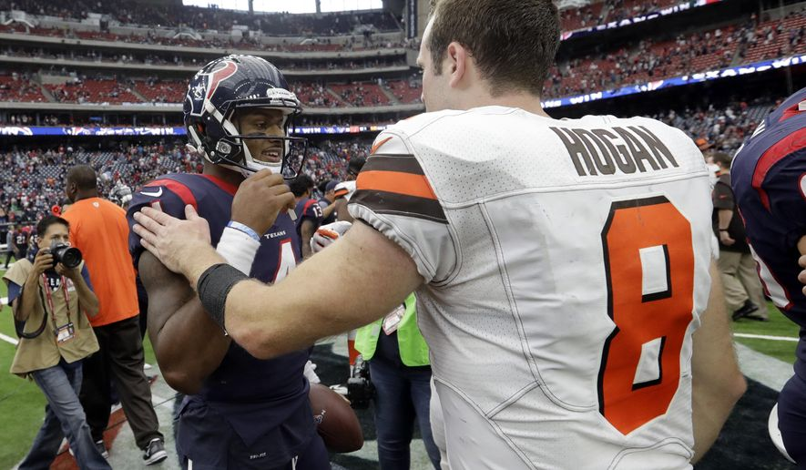 Houston Texans' Deshaun Watson (4) and Cleveland Browns' Kevin Hogan (8) meet at midfield after their NFL football game, Sunday, Oct. 15, 2017, in Houston. (AP Photo/Eric Gay)