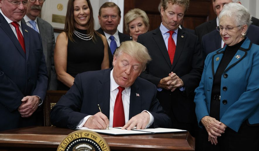"FILE - In this Thursday, Oct. 12, 2017, file photo, Dave Ratner, second from left, and others watch as President Donald Trump signs an executive order on health care in the Roosevelt Room of the White House in Washington. Ratner, owner of Dave's Soda and Pet City in Massachusetts, is under fire after he was photographed last week with Trump. Ratner said he's ""embarrassed"" and wouldn't have gone had he known Trump would also cut off federal payments to insurers. (AP Photo/Evan Vucci, File)"