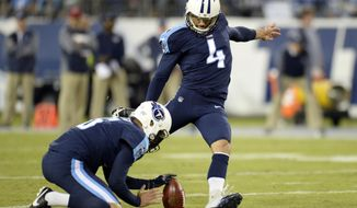 Tennessee Titans kicker Ryan Succop (4) kicks a 48-yard field goal as Brett Kern (6) holds in the first half of an NFL football game against the Indianapolis Colts Monday, Oct. 16, 2017, in Nashville, Tenn. (AP Photo/Mark Zaleski)