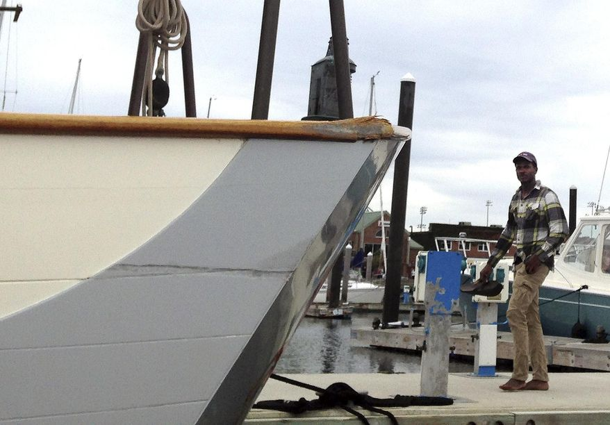 CORRECTS NAME OF BOAT FROM MAIN COURSE TO TRADE WIND -- Damage is visible on the boat Trade Wind in Newport Harbor, Monday, Oct. 16, 2017, in Newport, R.I., after it was struck Sunday evening by the tall ship SSV Oliver Hazard Perry, which lost power and began to drift in the harbor. (AP Photo/Jennifer McDermott)