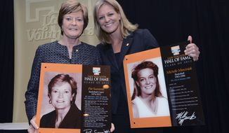 This Nov. 2, 2012, photo provided by the University of Tennessee Athletics Department, shows Pat Summitt, left, and Michelle Marciniak at Lady Vol Hall of Fame induction ceremonies in Knoxville, Tenn. Michelle Brooke-Marciniak played for Pat Summitt on Tennessee's 1996 national championship team and now serves as a board member on her former coach's foundation. Brooke-Marciniak will honor Summitt once again this week as she joins a group of cyclists riding 1,098 miles - one mile for each of Summitt's career wins - to raise money and awareness in fighting Alzheimer's disease. (Wade Rackley/University of Tennessee Athletic Department via AP)