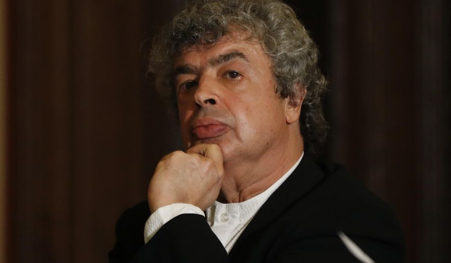 Semyon Bychkov meets with media after being appointed The Czech Philharmonic new chief conductor and music director  at the Rudolfinum concert hall in Prague, Czech Republic, Monday, Oct. 16, 2017. (AP Photo/Petr David Josek)