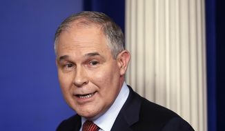 In this June 2, 2017, file photo, EPA Administrator Scott Pruitt looks back after speaking to the media during the daily briefing in the Brady Press Briefing Room of the White House in Washington. (AP Photo/Pablo Martinez Monsivais)
