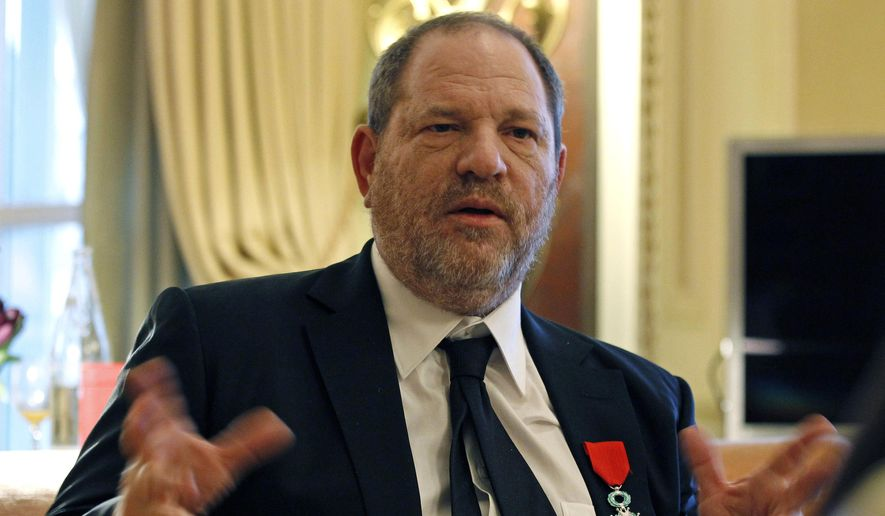 In this March 7, 2012, file photo, U.S film producer and movie studio chairman Harvey Weinstein during an interview with The Associated Press in Paris, the same day as Weinstein received, Chevalier of the Legion of Honor by French President Nicolas Sarkozy. French President Emmanuel Macron says Sunday Oct. 15, 2017, that he wants to revoke Harvey Weinstein's Legion of Honor award after the wave of accusations of sexual harassment and abuse against the Hollywood titan. (AP Photo/Remy de la Mauviniere, File)
