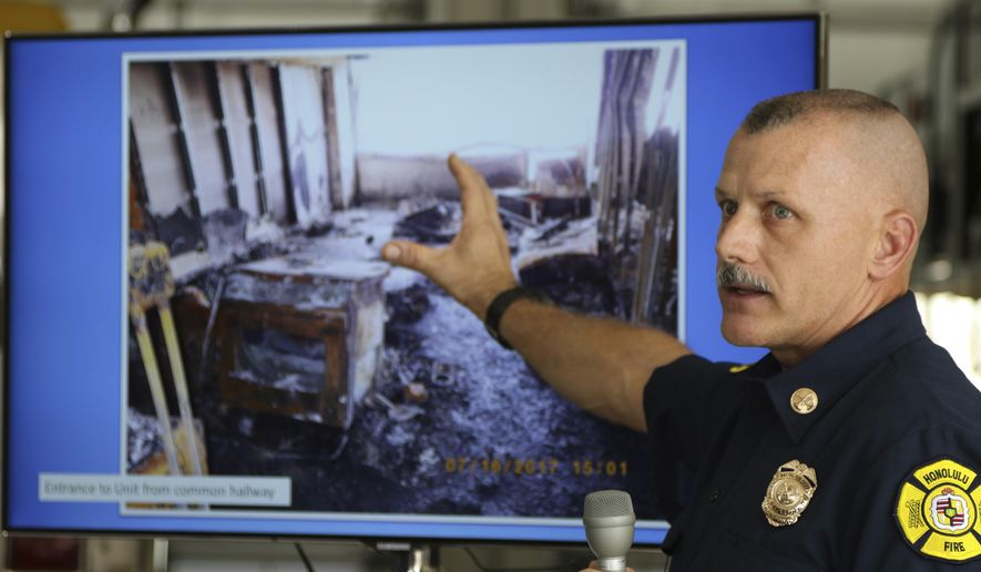 Honolulu Fire Battalion Chief Jeff Hooker speaks during a news conference about the Marco Polo high-rise apartment fire investigation, Monday, Oct. 16, 2017 in Honolulu. The cause of a deadly high-rise apartment building fire that claimed four lives and resulted in more than $107 million in damage cannot be determined, Honolulu fire officials said Monday. (AP Photo/Caleb Jones)
